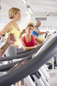 pic of encouraging  - Woman On Running Machine In Gym Encouraged By Personal Trainer - JPG