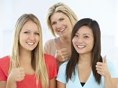 stock photo of dress-making  - Group Of Happy And Positive Businesswomen In Casual Dress Making Thumbs Up Gesture - JPG