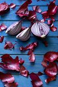 picture of red shallot  - halved red onion on a blue wooden background - JPG