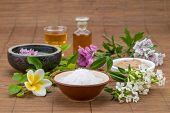 stock photo of salt-bowl  - mask white bowl essential oil salt bowl flower background for health spa - JPG