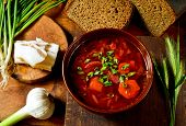 stock photo of red clover  - Ukrainian national red soup borscht with salted pork fat and greens - JPG