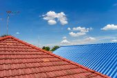 picture of red roof  - red and blue roof tiles photo - JPG