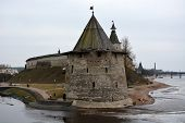 image of fortified wall  - Stone tower and Pskov Kremlin fortress wall at the confluence of two rivers - JPG