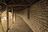 stock photo of fortified wall  - Top of the wall in the old Pskov Kremlin - JPG
