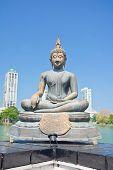 stock photo of vihara  - The Statues Of Seema Malakaya At The Gangarama Temple In Beira Lake - JPG