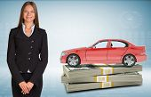 stock photo of bundle  - Businesslady with red car standing on bundle of money on abstract blue background - JPG