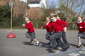 stock photo of playground school  - Group Of Elementary School Pupils Running In Playground - JPG