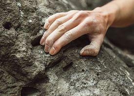 foto of climb up  - Woman climbing on rock outdoor close - JPG