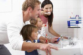 stock photo of pyjama  - Family In Bathroom Brushing Teeth - JPG