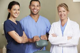 foto of nursing  - Portrait Of Dentist And Dental Nurses In Surgery - JPG