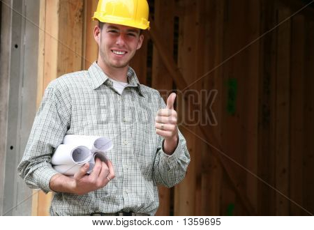 Picture or Photo of A home contractor holding blueprints outside a home in progress