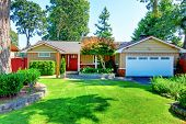 Cute Small Rambler House With Red Door And White Garage Door. poster