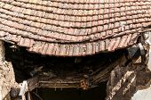 Damaged Roof. Old Abandoned House Collapsed Roof With Damaged Vintage Tiles After Natural Disaster O poster