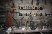 Old Laboratory Mining Tools And Measuring Devices. Bottles On Shelf In Old Pharmacy Laboratory. Old  poster