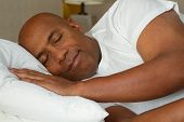 African American Mature Man Getting A Good Nights Rest. poster