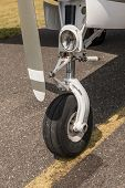 A Bow Of A Small Sport Aircraft. Wheel Of Airplane. Close Up Of Aircraft Wheel On Runway. Plane Whee poster