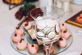 Delicious Macaroons In Glass And Cupcakes,pops And Candy On Table At Wedding Reception. Candy Bar. T poster