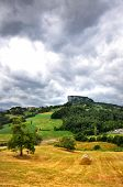 stock photo of alighieri  - a view of the famous Pietra di Bismantova with contrasts and a dramatic sky - JPG