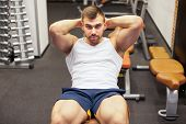 Sport, Fitness, Bodybuilding, Lifestyle And People Concept - Young Man Doing Sit-up Abdominal Exerci poster