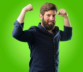 Young hipster man with big beard showing biceps expressing strength and gym concept, healthy life it poster
