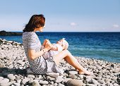 Happy Young Family. Mother And Baby Playing Outdoors On The Sea Beach. Portrait Loving Mom With Daug poster
