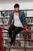 Handsome College Student In A Library poster