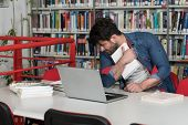 Bored Student With Books In Library poster