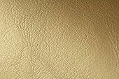 Gold Gradient Background. Gold Or Bronze Natural Leather Background. Shiny Yellow Leaf Gold Foil Tex poster