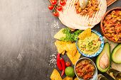 Mexican Food Mix: Nachos, Fajitas, Tortilla, Guacamole And Salsa Sauces And Ingredients Over Black B poster