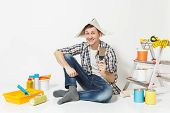 Happy Smiling Young Man In Newspaper Hat With Putty Knife Instruments For Renovation Apartment Room poster