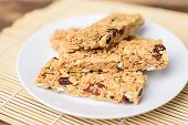 Snack Bar Or Energy Bar On White Dish, Healthy Food poster
