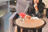 Business Concept.young Asian Businesswoman Is Working Happily.young Businesswoman Working In A Cafe. poster