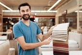 Satisfied Bearded Man Choose Color On Color Palette. Selecting Color Of Mattress On Color Palette Gu poster