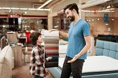 Bearded Man With Young Boy Chooses Color On Color Palette. Selecting Color Of Mattress On Color Pale poster