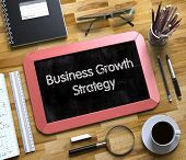 Business Growth Strategy - Red Small Chalkboard With Hand Drawn Text And Stationery On Office Desk.  poster