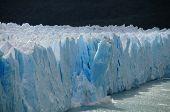 A Giant Piece Of Ice Breaks Off The Perito Moreno Glacier In Patagonia, Argentina poster