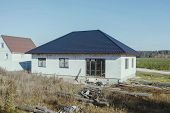 House With A Gray Metal Roof. Modern Roof Made Of Metal. Corrugated Metal Roof And Metal Roofing. poster