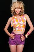 stock photo of halter-top  - Pretty slim blonde in vintage halter and shorts - JPG