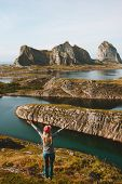 Woman Adventurer Raised Hands Traveling In Norway Mountains Rocks And Sea View Adventure Vacations H poster