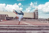 Young Active Dancer Is Standing On One Arm In Jump, A Sport Man, City Summer, Break-dancer , Hip-hop poster
