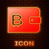 Glowing Neon Cryptocurrency Wallet Icon Isolated On Brick Wall Background. Wallet And Bitcoin Sign.  poster
