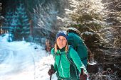 Woman With Backpack And Snowshoes In The Winter Mountains. Travel To Scenic Places. Portrait Of A Bl poster