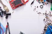 Flat Lay Of Electronic Components, Transistors, Multimeter, Brush, Resistors, Electronic Circuit Boa poster