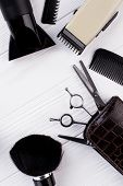 Set Of Hairdresser Tools And Accessories. Hairdressing Equipment On White Wooden Table. Space For Te poster