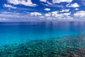 The Sea With Clear Turquoise Water And Blue Sky With Clouds On A Clear Day. poster