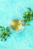 Mint Tea Cup, Top Shot On A Vibrant Turquoise Background With Fresh Mint Leaves And A Place For Text poster