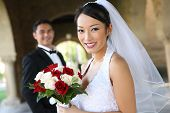 stock photo of wedding couple  - A beautiful bride and handsome groom at church during wedding - JPG
