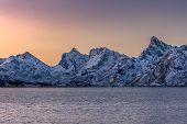Dramatic Sunset Over Lofoten Islands, Norway. Amazing Dramatic Sunset Over Lofoten Islands, Norway.  poster