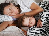 The Baby Sleeps With Mom In Bed. Cute Boy And His Mother Lying On The Sofa In The Bedroom, Sleep Pea poster