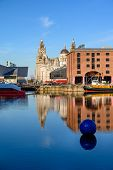 Tall Shot Across The Albert Dock, Of The Liver Building In Liverpool On A Very Sunny Day. poster